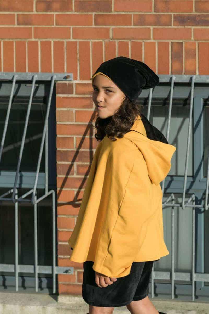 wearing a cape