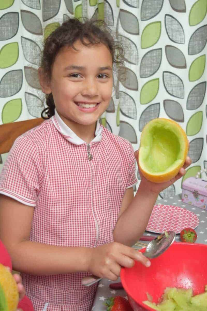 water melon carving baby shower idea scooping the melons