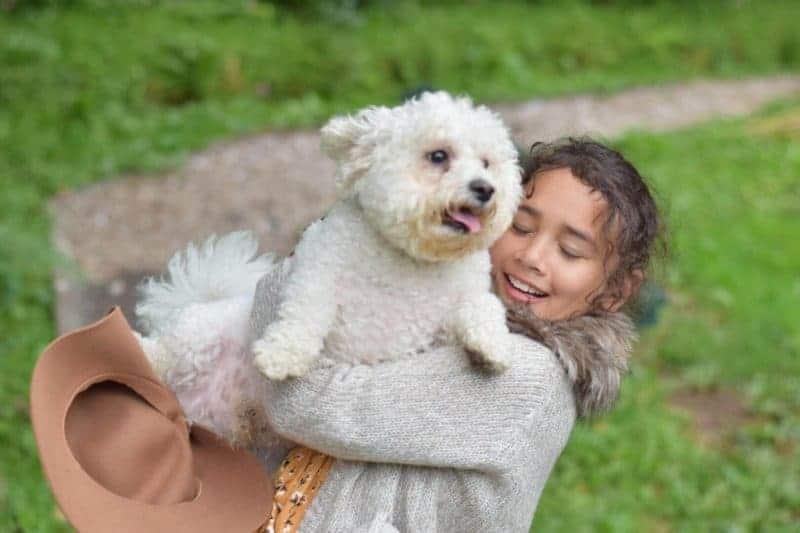sylvia cuddling Yoda the dog