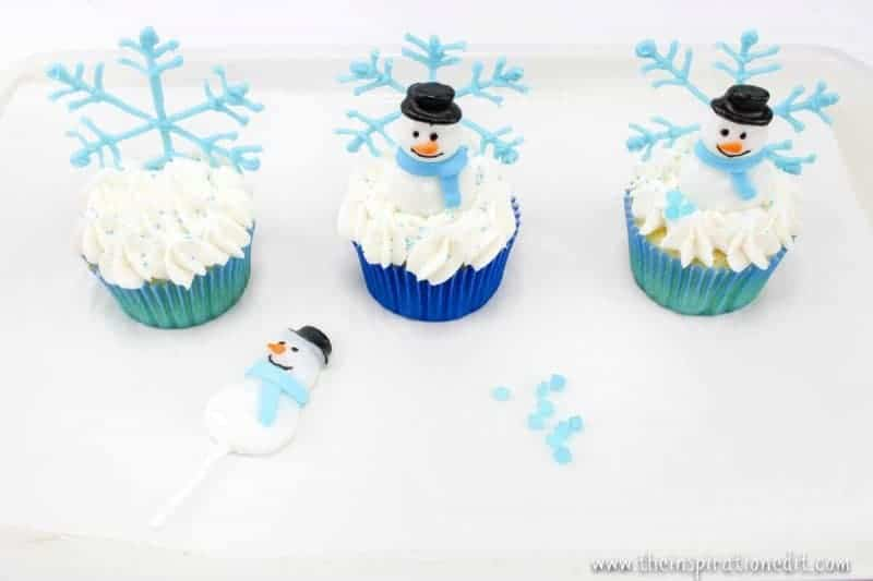 decorating snowmen on cupcakes