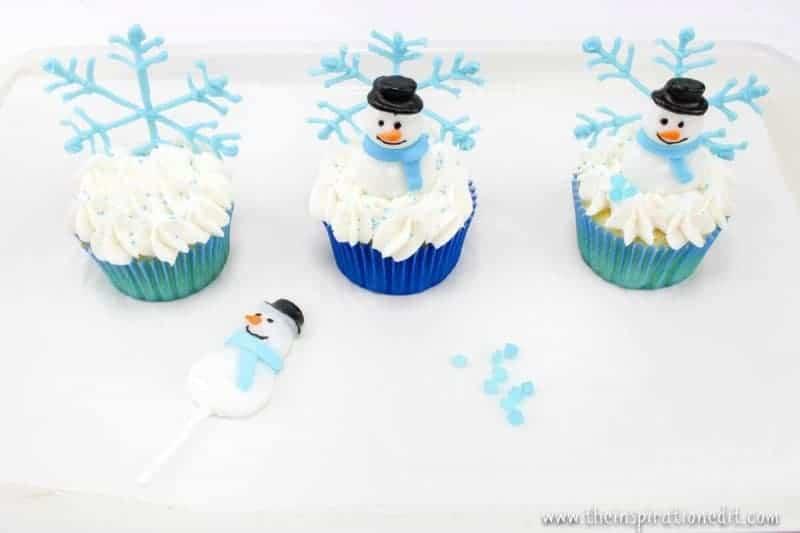 decorating snowmen on cupcakes