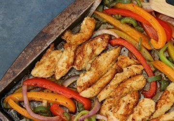 Weight Watchers healthy chicken fajitas recipe with the fajitas on a sheet pan