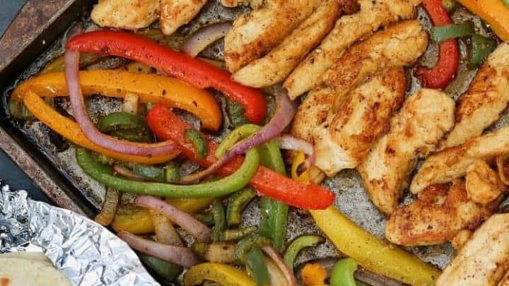 Weight Watchers healthy chicken fajitas recipe with the fajitas on a sheet pan