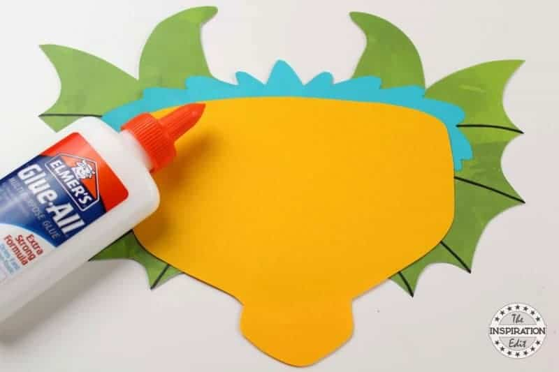 gluing the preschool dragon craft