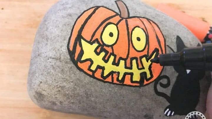 Halloween themed Pumpkin Painted Rocks