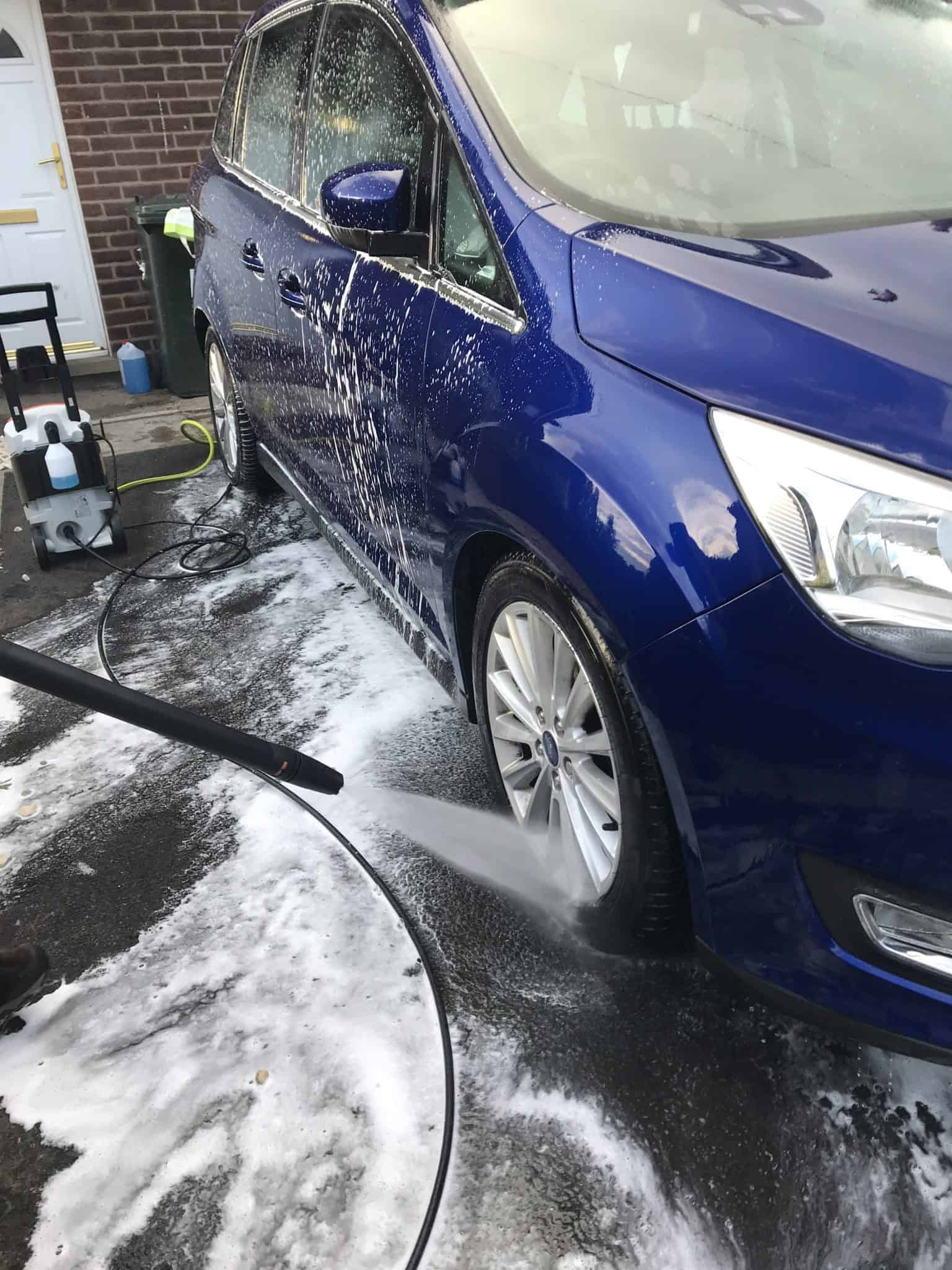 washing the car with a STILH RE 98 pressure washer