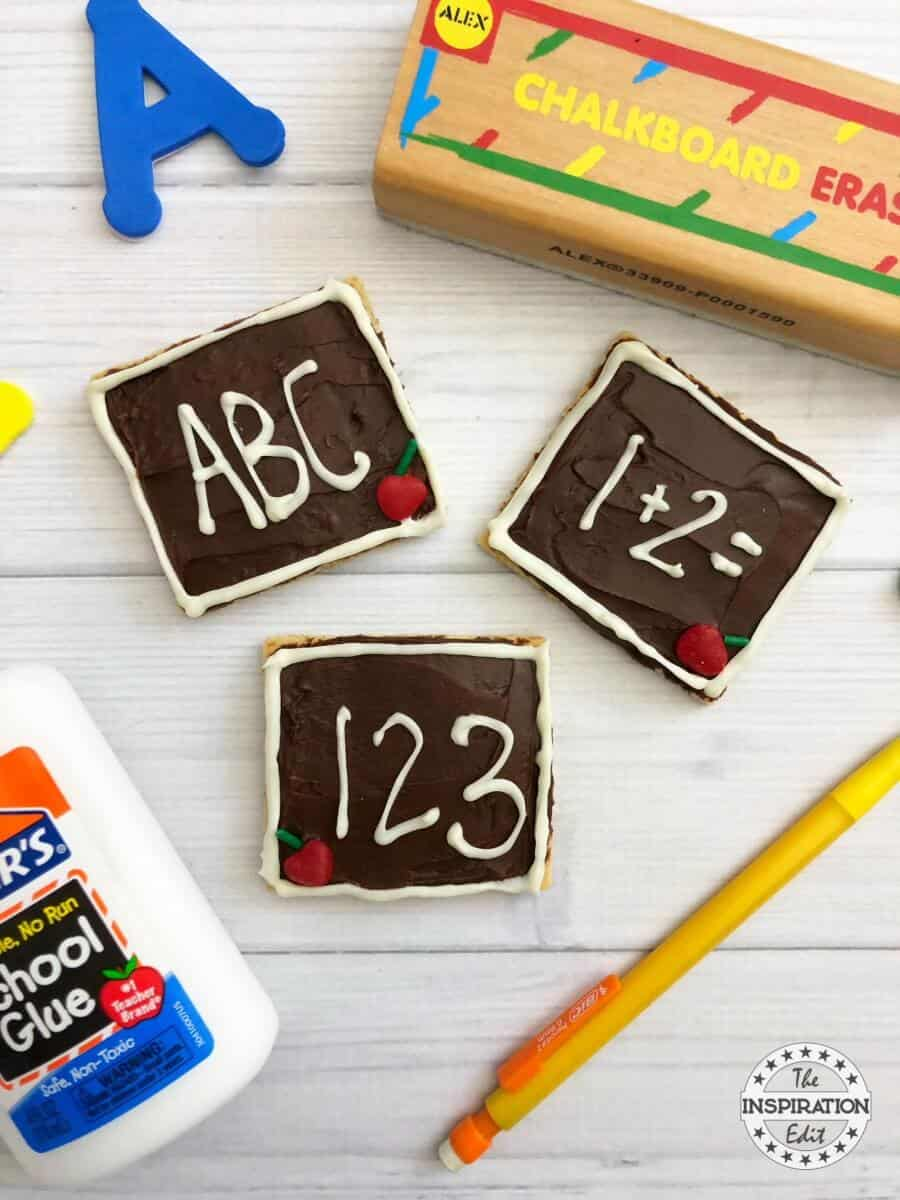 Graham Cracker Recipe back to school themed cracker with icing and the alphabet letters made form icing.