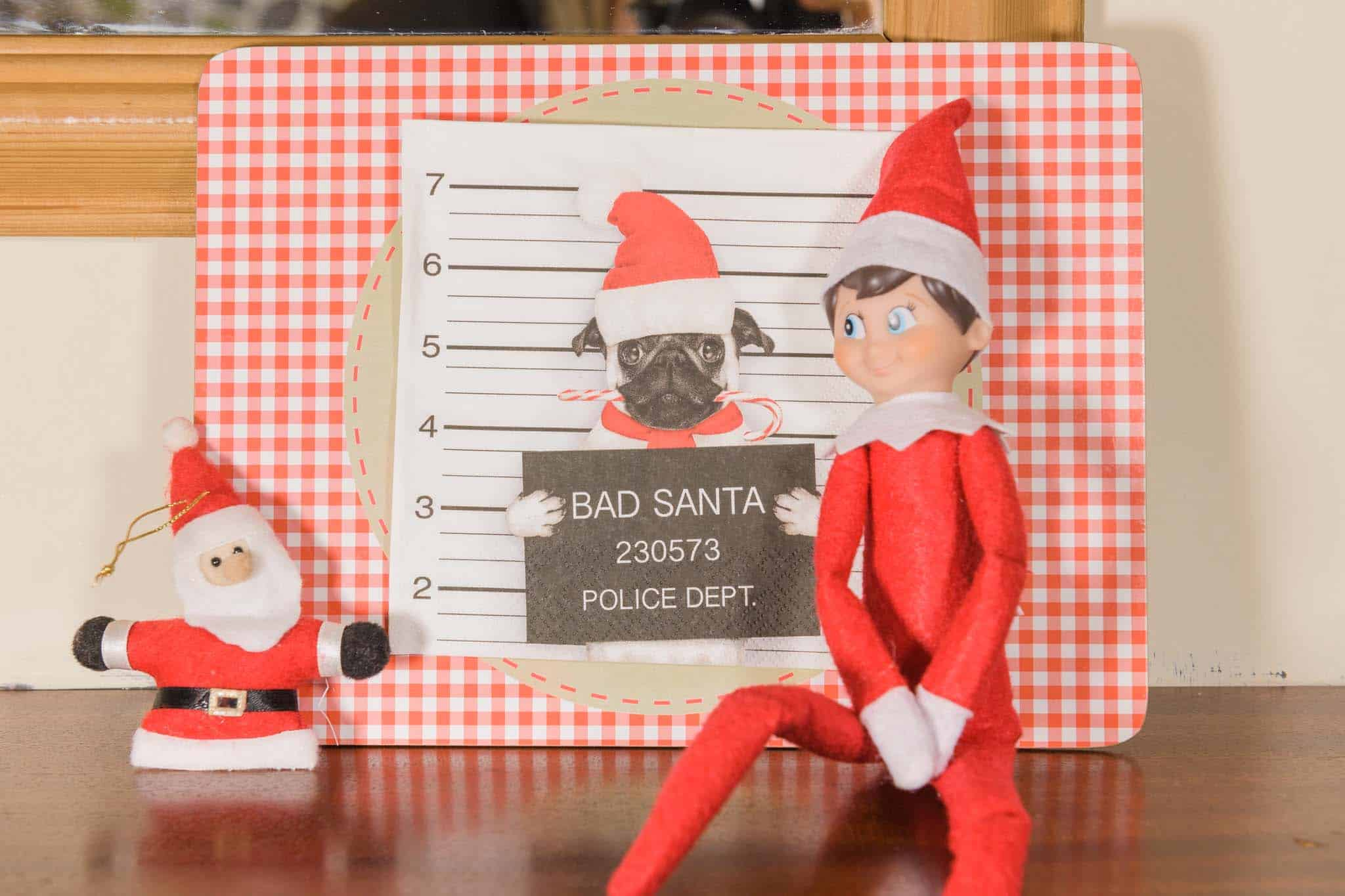 easy elf on the shelf ideas The elf sitting next to santa.