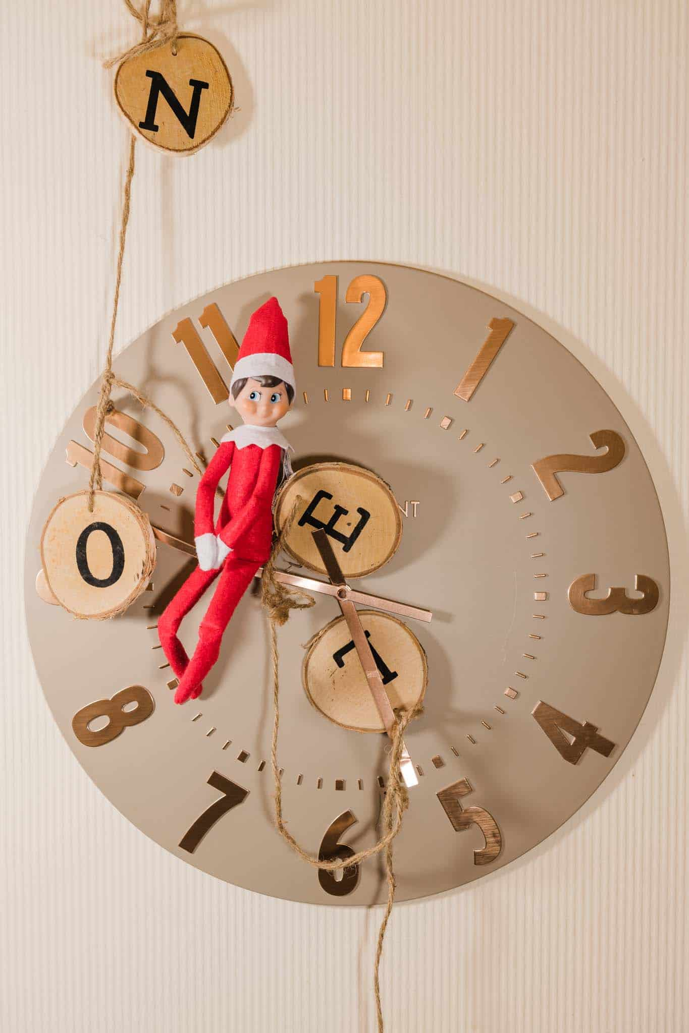 naughty Elf On The Shelf On The Clock