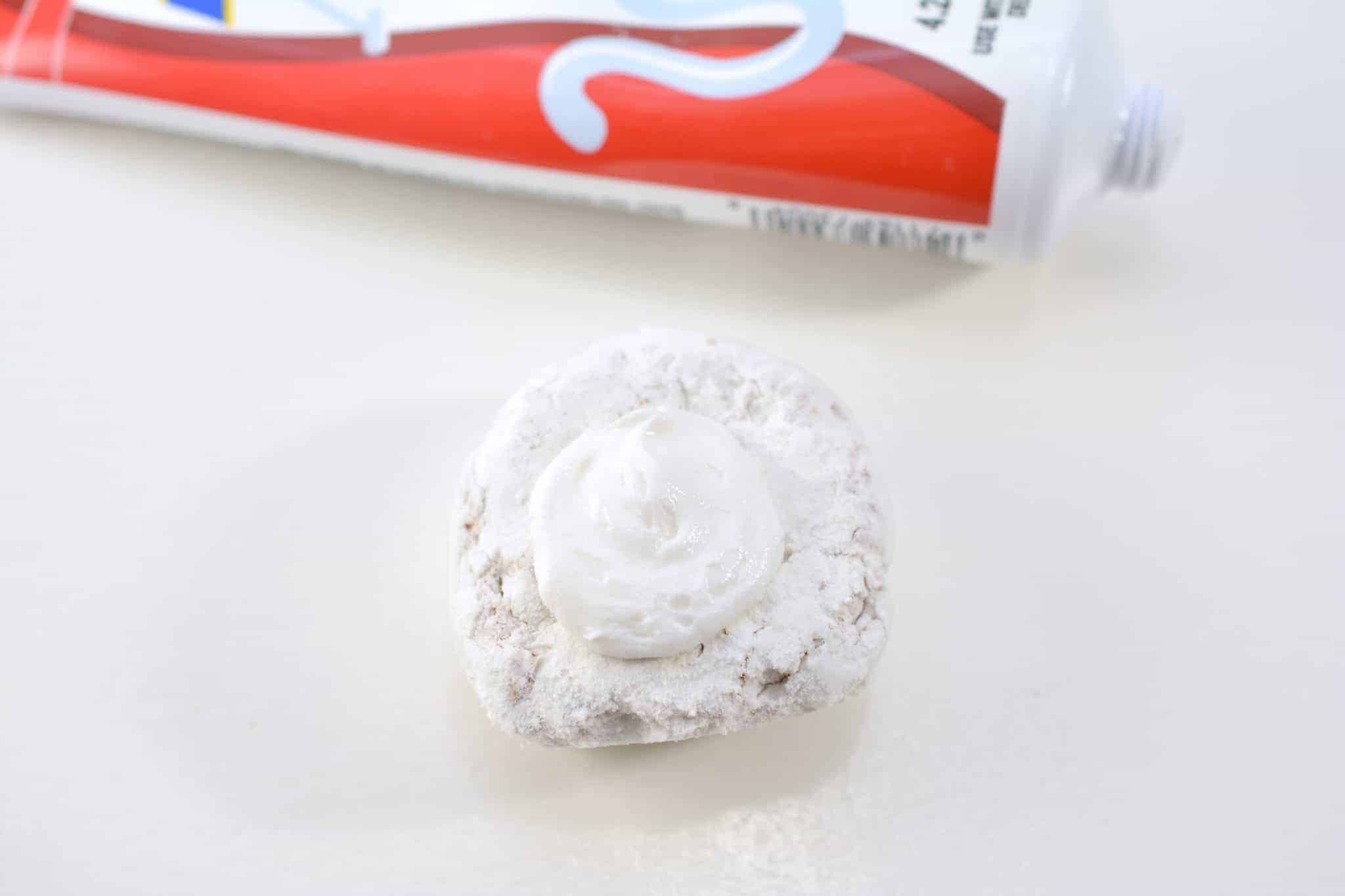 powdered donut with icing on it