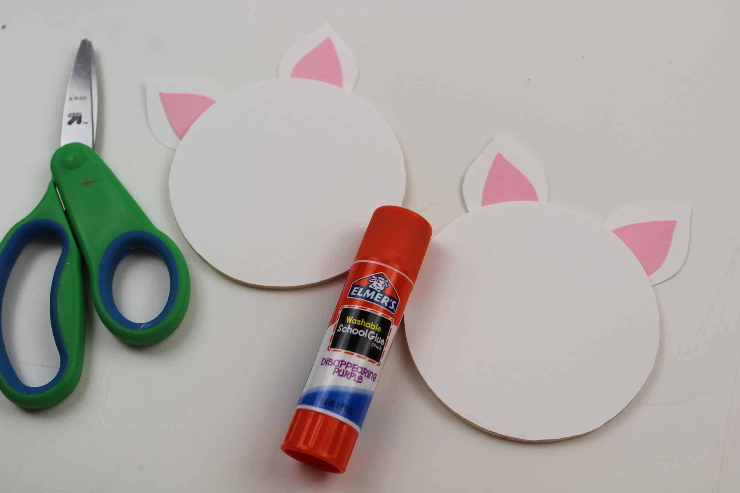 gluing unicorn ears to your unicorn magnet a easy unicorn craft for kids