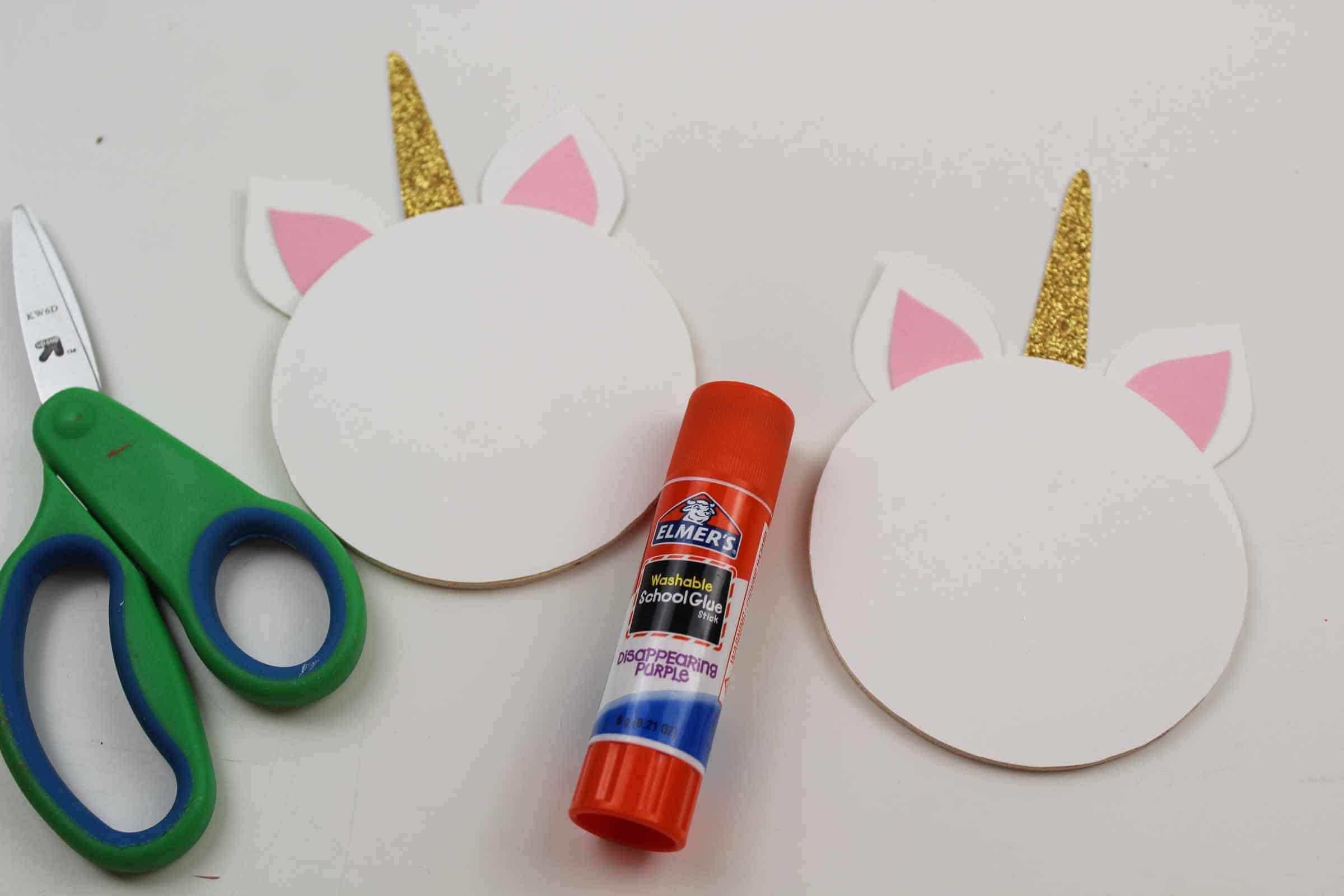gluing the unicorn horn to the unicorn craft