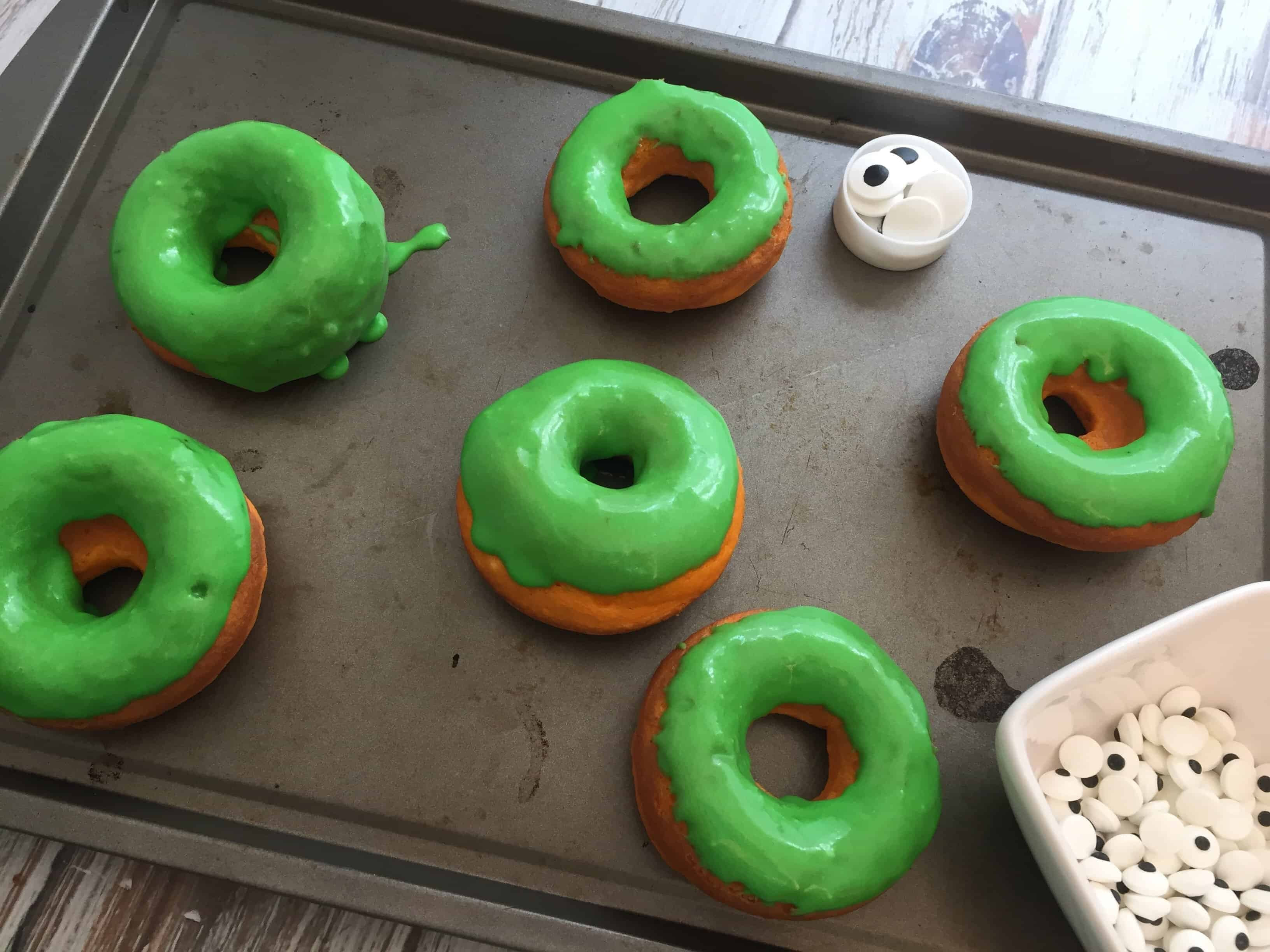 Glazing the Halloween Monster Donuts