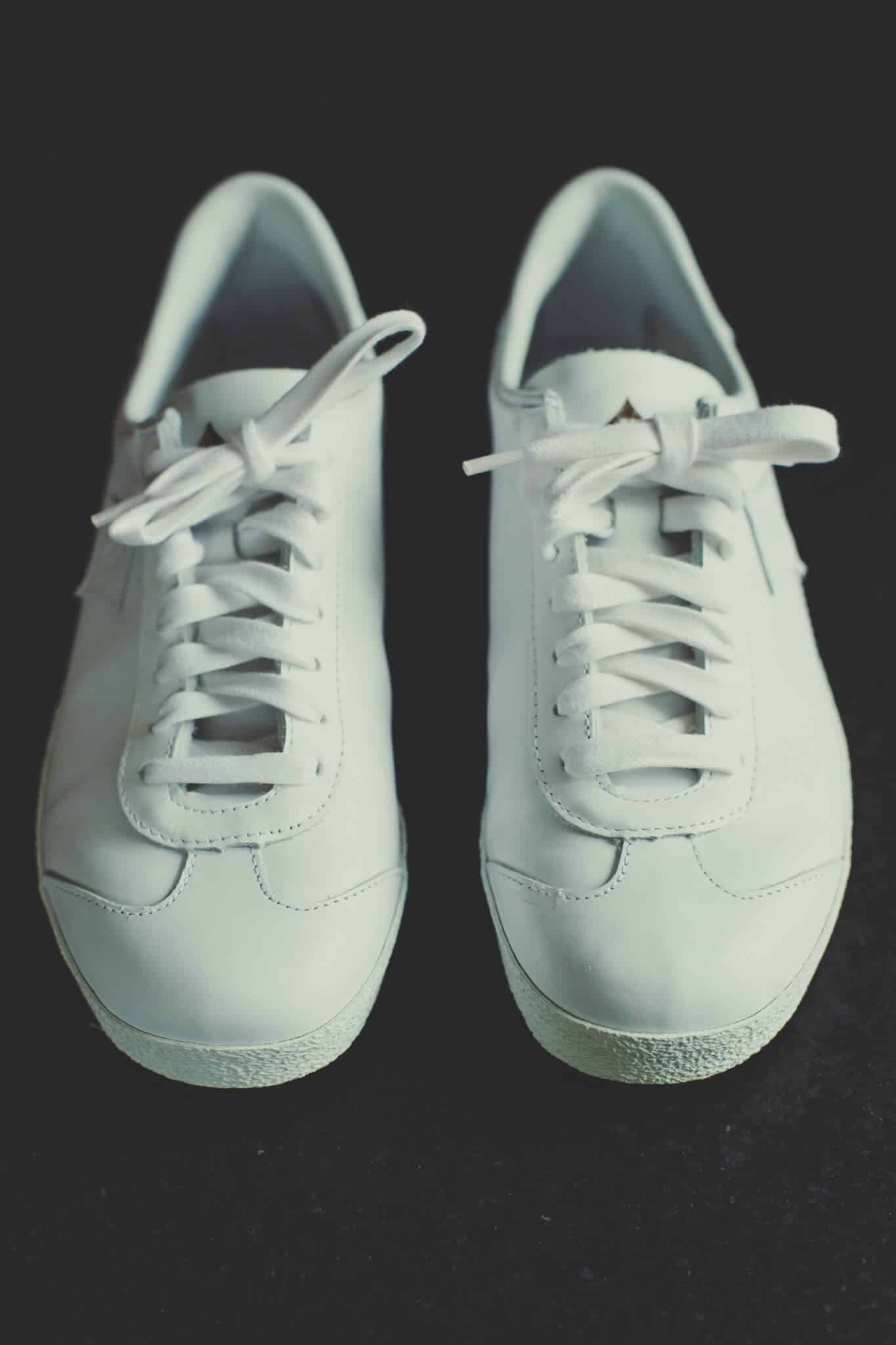 A Pair of White minimalist sneakers