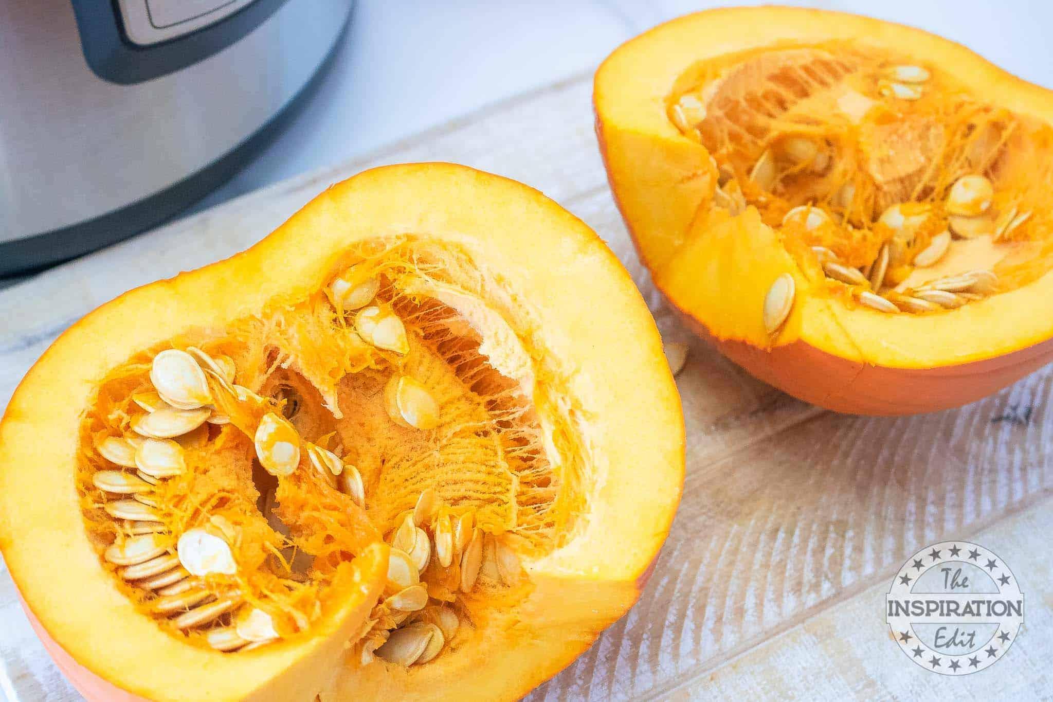 scrape the pumpkin seed to deseed the pumpkin for pumpkin puree recipe