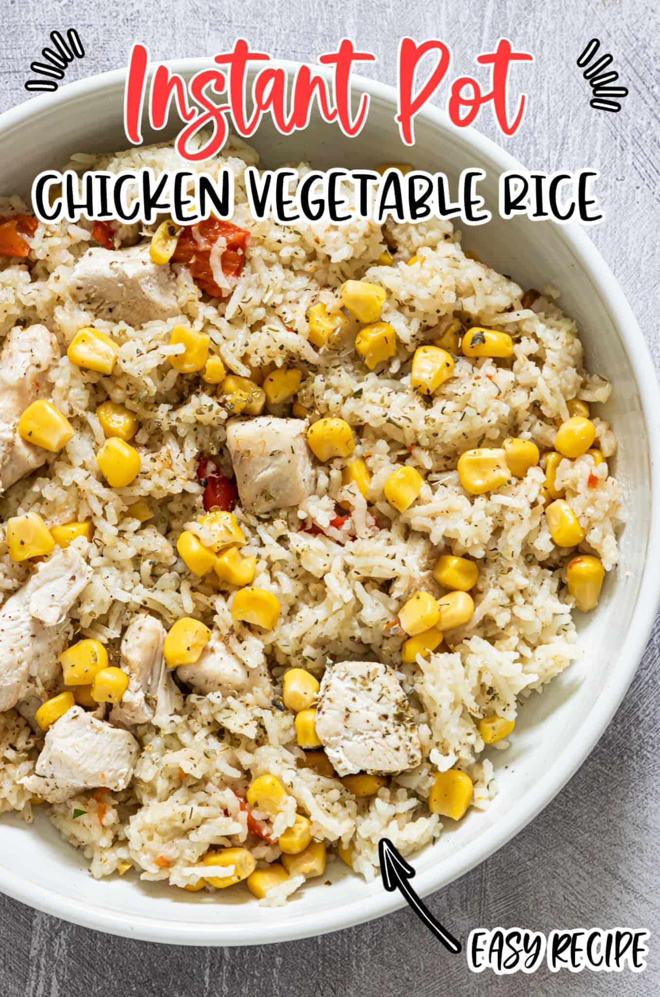 chicken and vegetable rice in a white bowl