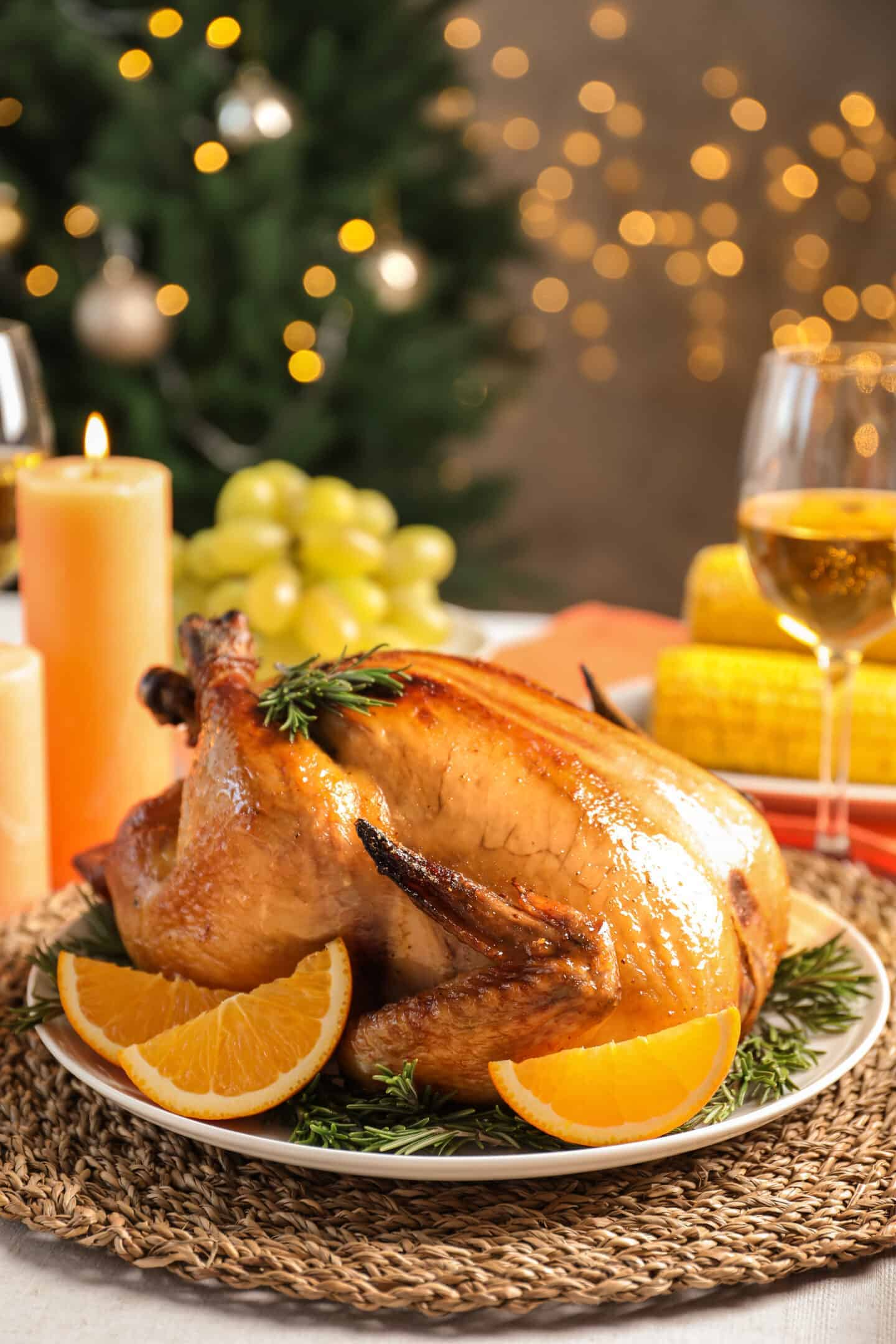 Delicious roasted turkey with garnish on dinner table