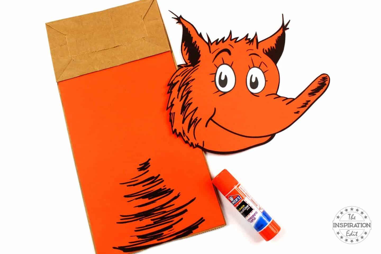 glue orange paper to fox in socks paper bag